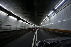 Car speeding and turning tunnel Stock Photos