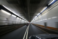 Car speeding and turning tunnel Royalty Free Stock Photo