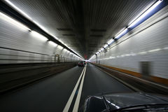 Car speeding and turning tunnel Royalty Free Stock Images