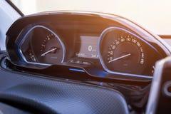 Car speedometer close up. Modern car interior with blue led light.  Stock Photo