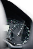 Car speedometer close-up with the needle pointing a high 130 km/ Royalty Free Stock Photos