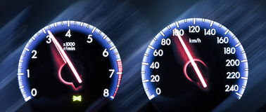 Car Speedometer on dark background Stock Images