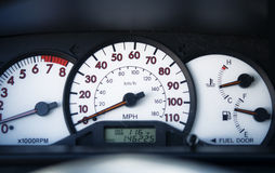 Car speedometer on dashboard royalty free stock images