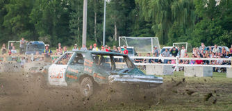 Demolition Derby Flying dirt. A car spinning and spitting dirt at the Chesterville, Ontario, Canada demolition derby in July of 2012 Stock Photos