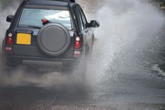 Car Splash. A Car Driving Through a Water Flood stock images