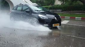 A car splashing water from a puddle of water stock footage