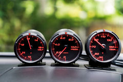 Car Sport racing gauge meter on car console. Royalty Free Stock Photo