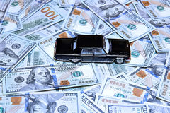 Car on stack of dollars Royalty Free Stock Image
