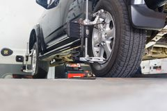 Car on stand with sensors. On wheels for wheels alignment camber check in workshop of Service station Royalty Free Stock Image