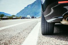 Car is standing on the breakdown lane, asphalt and tyre, Italy. Close up of a car standing on a breakdown lane, summer vacation, tyre, broken, wheel, highway royalty free stock photos