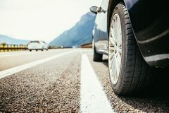 Car is standing on the breakdown lane, asphalt and tyre, Italy. Close up of a car standing on a breakdown lane, summer vacation, tyre, broken, wheel, highway stock images