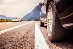 Car is standing on the breakdown lane, asphalt and tyre, Italy. Close up of a car standing on a breakdown lane, summer vacation, tyre, broken, wheel, highway stock photos