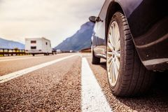 Car is standing on the breakdown lane, asphalt and tyre, Italy. Close up of a car standing on a breakdown lane, summer vacation, tyre, broken, wheel, highway royalty free stock images