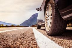 Car is standing on the breakdown lane, asphalt and tyre, Italy. Close up of a car standing on a breakdown lane, summer vacation, tyre, broken, wheel, highway royalty free stock image