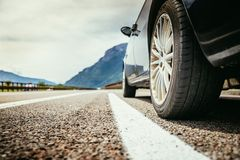 Car is standing on the breakdown lane, asphalt and tyre, Italy. Close up of a car standing on a breakdown lane, summer vacation, tyre, broken, wheel, highway royalty free stock photo