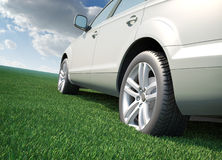 Car standing in a field of grass. Ecological transport concept Stock Photo