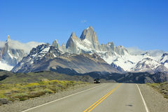 Car standing on road to mountain Fitz Roy in Patagonia Stock Photos