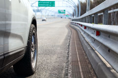 Car standing on wayside of highway with road view. At distance royalty free stock photography