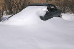 Car captured with thick snow. A car standing in the yard and buried in thick snow royalty free stock photos