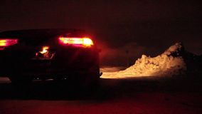 Car stands on the roadside, flashing emergency lights stock footage