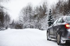The car stands on a snow-covered road Royalty Free Stock Images
