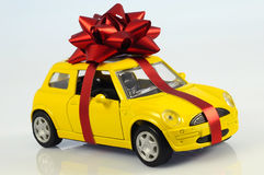 Car with staple gift. On neutral background royalty free stock image