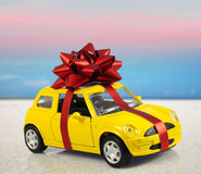 Car with staple gift. On surreal background Stock Photo