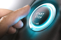 Car Start and Stop Button. Car stop start system with finger pressing the button, horizontal image Royalty Free Stock Photo
