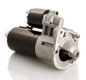 Car starter isolated. Automotive starter motor and solenoid Stock Photography