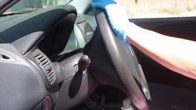 Car steering virus sanitization with blue spray jet and sanitizing wipe