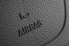 Car steering wheel airbag security system. Close up of a car steering wheel airbag security system Stock Photography