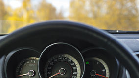 Car steering wheel in autumn. Car steering wheel and dashboard in autumn Stock Image