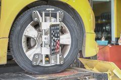 Car Steering Wheel Balancer Calibrate with laser reflector attach on each tire to center driving adjust.  stock image
