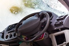 In the car, the steering wheel bent from the accident. Stock Image