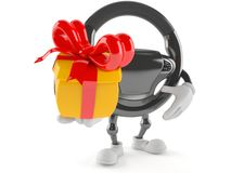 Car steering wheel character holding gift Stock Images