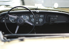 Car steering wheel and dashboard Royalty Free Stock Photos