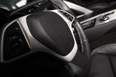 Car Steering Wheel. Driving Concept. Dark Car Interior with Steering Wheel Closeup Stock Photos
