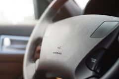 Car steering wheel with shallow depth of field Stock Photo