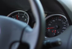 Car steering wheel and speedometer Stock Photos