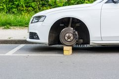 Car with stolen wheels Royalty Free Stock Photo