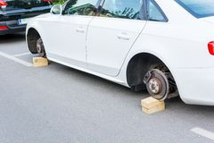 Car with stolen wheels Stock Images