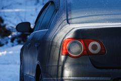 Car stop light in winter. covered with snow stop signals stock photo