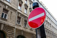 Car stop sign in the city on a building background Royalty Free Stock Images