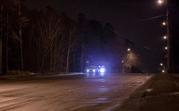 Car stopped by police. On an illuminated highway at night Royalty Free Stock Image
