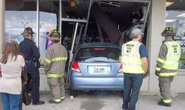 Car into store. Stock Photo