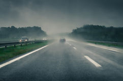 Car in storm Royalty Free Stock Image