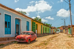 Car at street with colored buildings at Trinidad, Cuba Royalty Free Stock Photos
