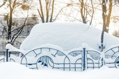 Car on a street covered with big snow layer. Royalty Free Stock Photos