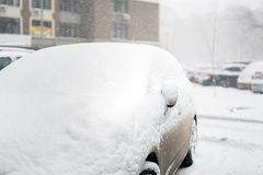 Car on a street covered with big snow layer. Royalty Free Stock Photography
