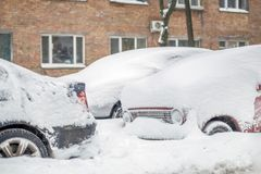 Car on a street covered with big snow layer. Stock Photos